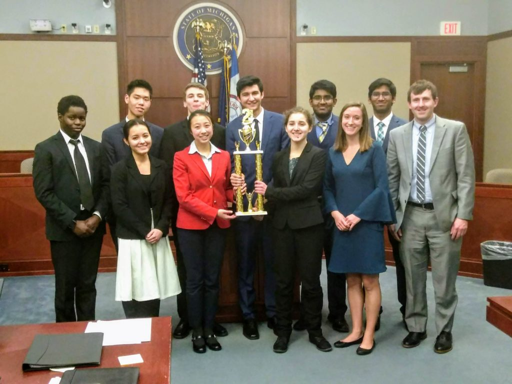Huron's Mock Trial team holding their trophy for second place in Michigan