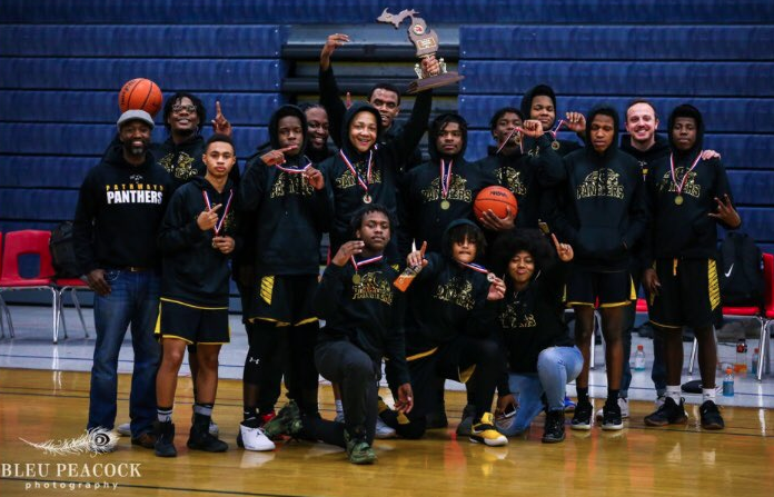 Pathways Basketball team celebrates with state championship trophy