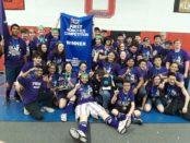 PiHi Samurai, Pioneer High School's robotics team celebrate with their championship banner