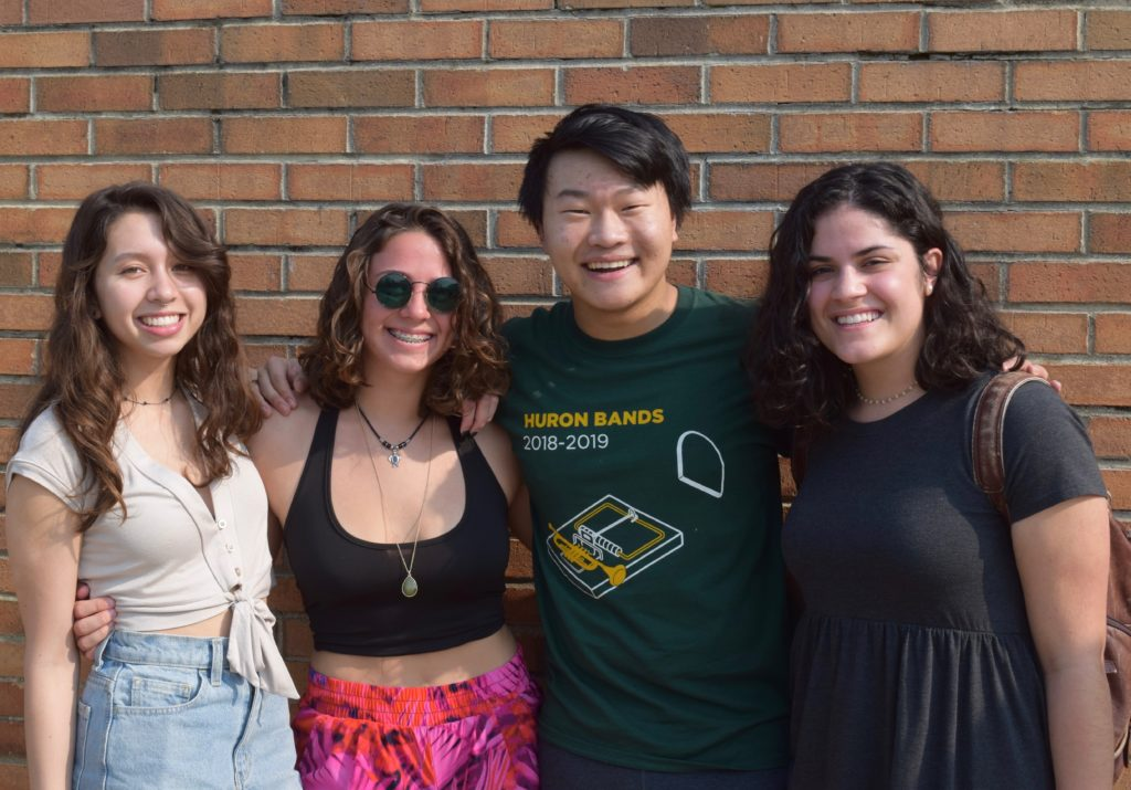 Four members of Huron High School's class of 2019 celebrate being done with school.