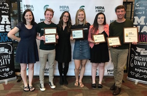 Community and Huron High School students that received MIPA Awards and their advisors.