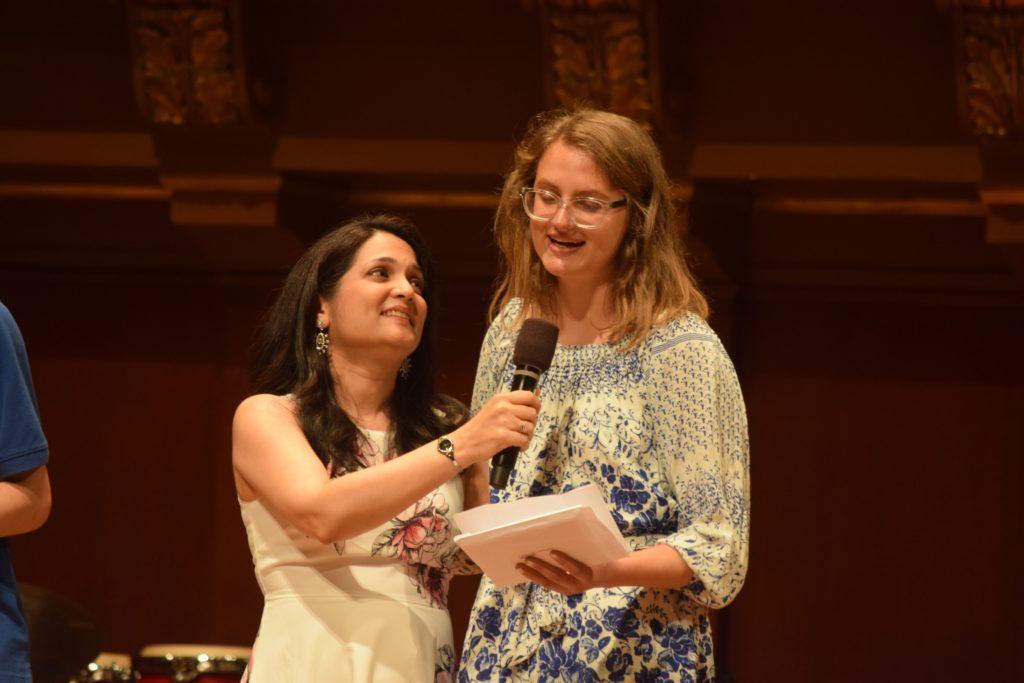 A female Community graduate gives her speech