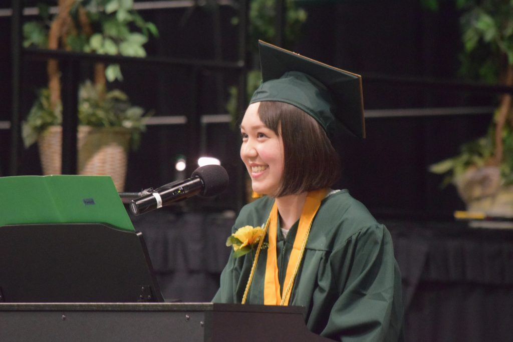 "2019 Graduate Kaye Hoffmayer plays the piano and sings her song ""Awake"""