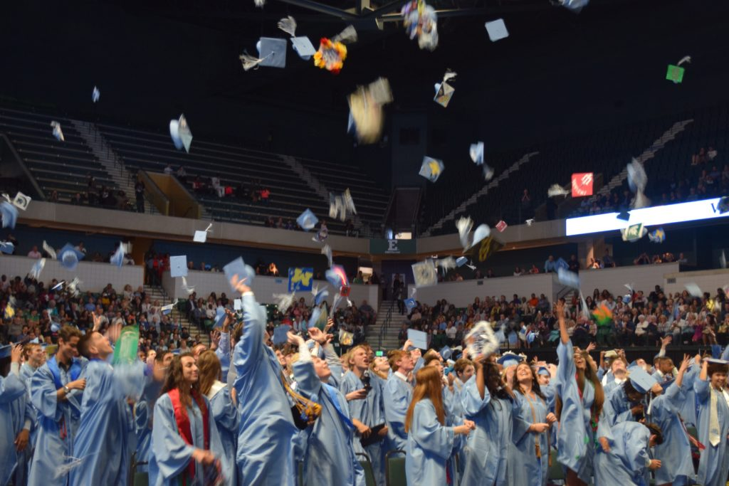 Skyline Class of 2019 throw caps into the air in celebration