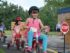 several young children riding tricycles in Safety Town