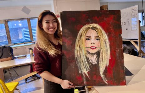 student Selina Lui with painting