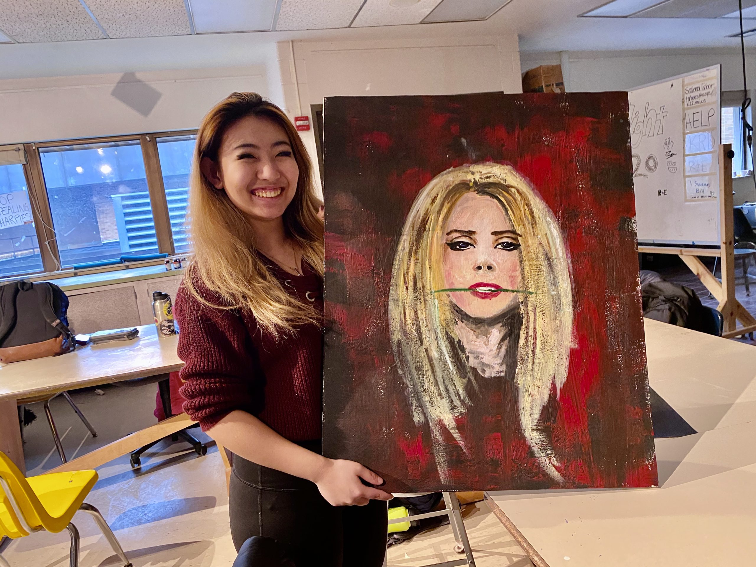 Senior DP student Selina Lui (who has been accepted into the University of Michigan Stamps School of Art & Design) poses with a painting she'll display at the exhibit.
