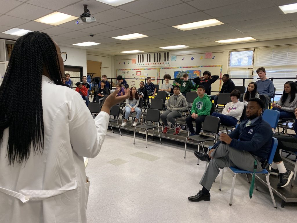 Dermatology Resident talks to students at Clague's Career Day.